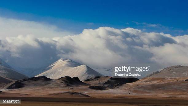 mountains in kyrgyzstan - kyrgyzstan stock pictures, royalty-free photos & images