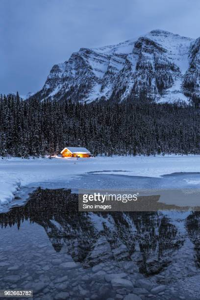 mountains in snow reflecting in lake, canada - image stock pictures, royalty-free photos & images