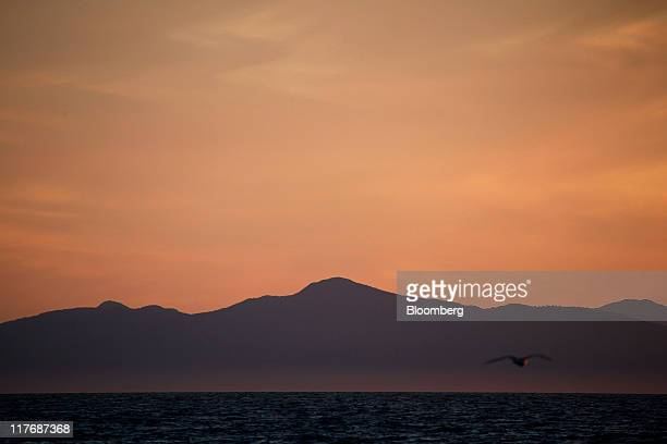 Mountains in the Hokkaido island are seen across Tsuruga Straits from Oma Town Aomori Prefecture Japan on Saturday June 25 2011 Over the 29 years...