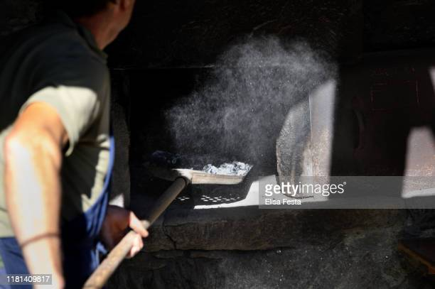 mountains: lighting the fire and preparing bread in an ancient oven - lentezza foto e immagini stock