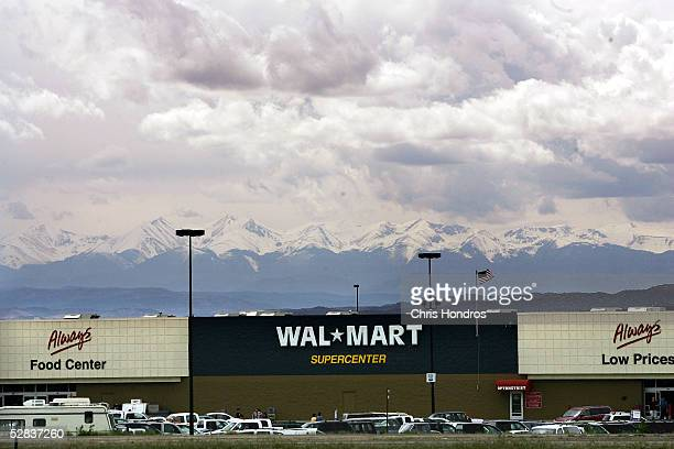 Mountains loom over a WalMart store May 15 2005 in Trindidad Colorado WalMarts are now nearly ubiquitous on the American landscape with over 3000...