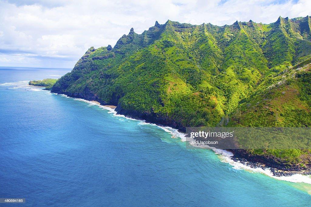 Mountains meet the shore in Kauai, Hawaii : Stock Photo