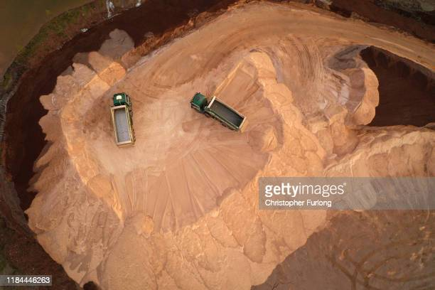 Mountains of rock salt are stockpiled above the Meadowbank salt mine in preparation for the winter weather on October 30 2019 in Winsford England The...