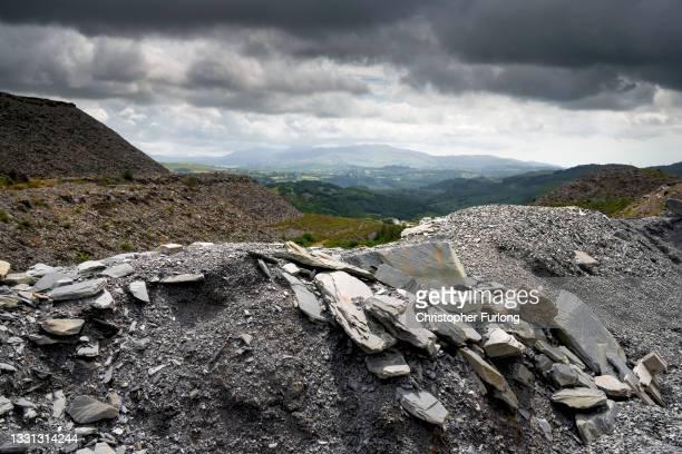 Mountains of slate create the landscape near the disused Maenofferen Slate Quarry on July 29, 2021 in Blaenau Ffestiniog, United Kingdom. The North...