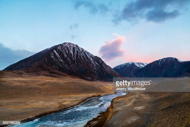 Mountains over river in remote landscape