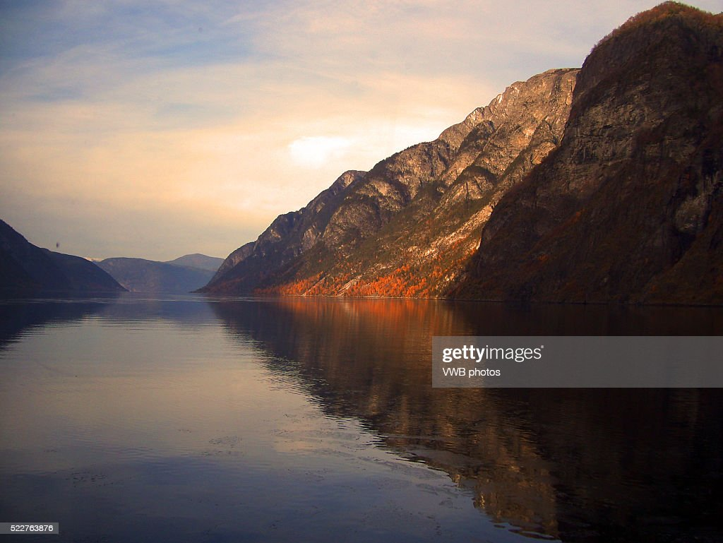 Mountains reflected in N��r��yfjord at Sunset, Norway : Stock Photo