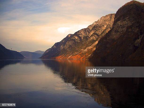 mountains reflected in n��r��yfjord at sunset, norway - reflection lake stock photos and pictures