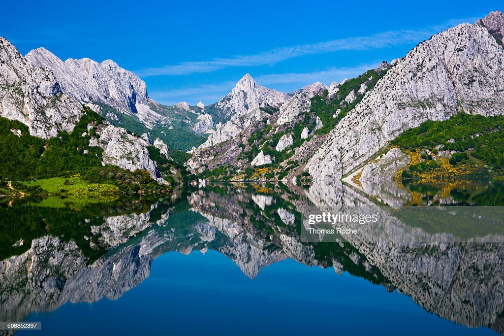 Mountains reflected in the lake at Riano, Spain : Stock Photo