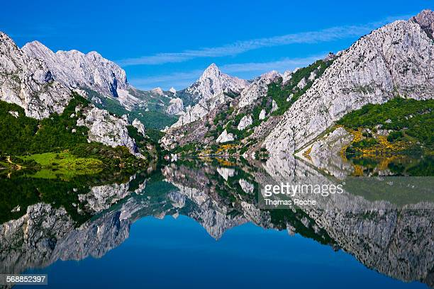 Mountains reflected in the lake at Riano, Spain