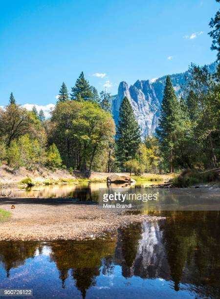 Mountains reflected in water, Merced River, Yosemite Valley, Yosemite National Park, UNESCO World Heritage Site, California, USA