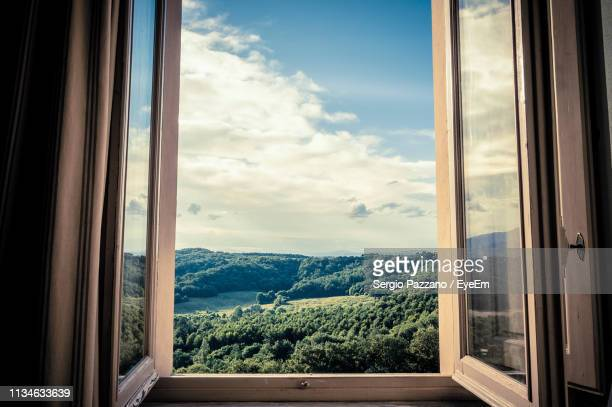 mountains seen through window - window frame stock pictures, royalty-free photos & images