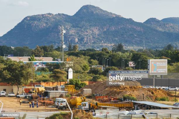 Mountains stand on the skyline beyond a commercial construction site in the central business district of Gaborone Botswana on Monday May 14 2018...