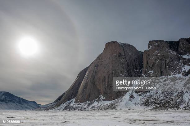 Mountains surround the frozen landscape of Akshayuk Pass, in Auyuittuq National Park on April 10, 2017 on Baffin Island, Canada.