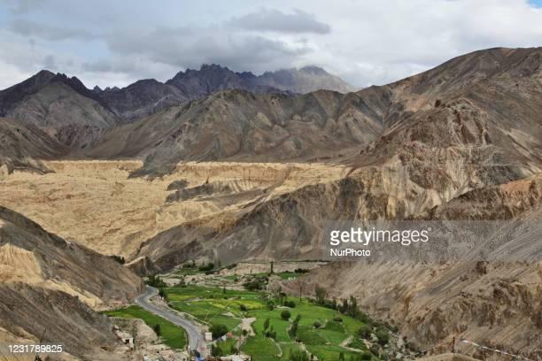 Mountains surround the remote Lamayuru village in Lamayuru, Ladakh, Jammu and Kashmir, India.