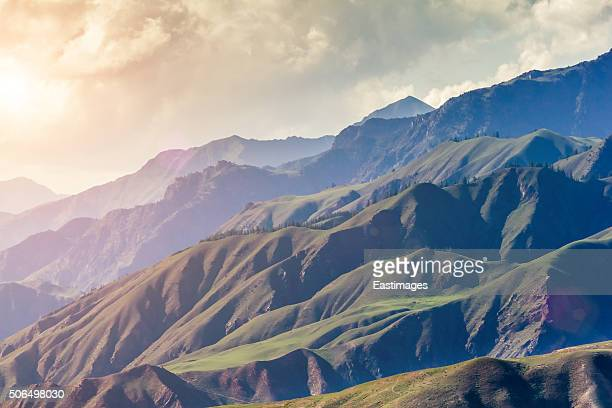 Mountains under cloudy sky and sunshine/Qinghai,China.