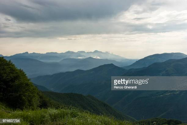 mountains under overcast sky, italy - renzo gherardi stock photos and pictures