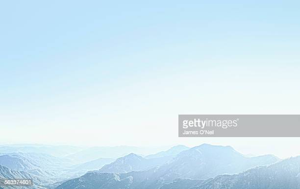 mountains with a sky blue haze - clear sky stock pictures, royalty-free photos & images
