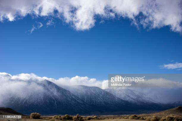 mountains with high desert in foreground. sierras near carson city,  nevada - carson california stock photos and pictures