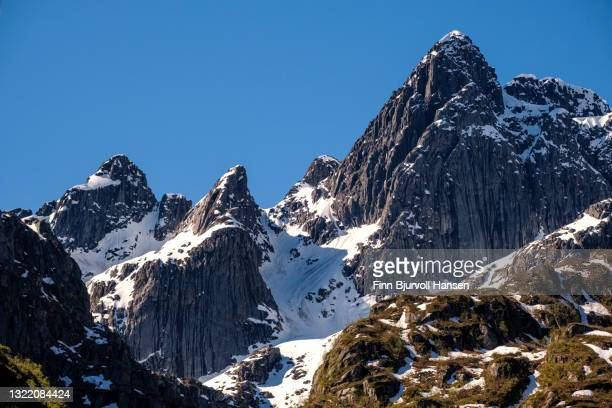 mountains with snow in trollfjorden, lofoten islands - finn bjurvoll stock pictures, royalty-free photos & images
