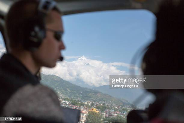 a mountainscape of the annapurna massif as seen from a helicopter in gandaki, nepal. - as stock pictures, royalty-free photos & images