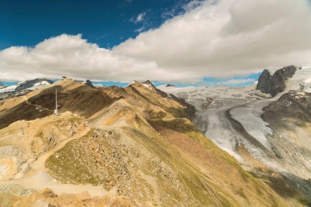 Mountainscape with summits among clouds, Zermatt, Valais, Switzerland