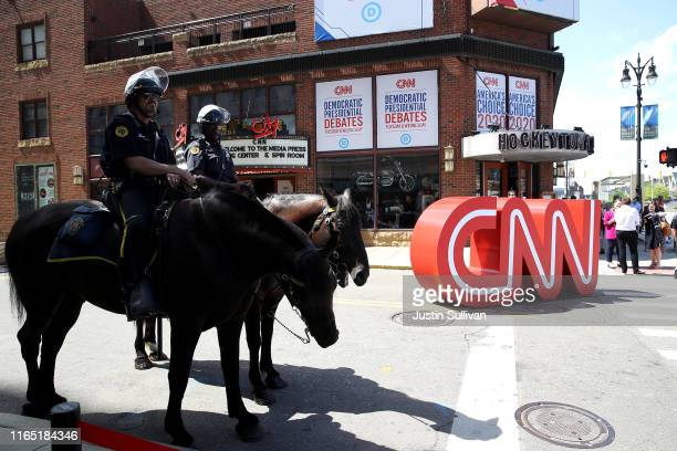 Mounted Detroit police officers work the area outside of tonight's Democratic Presidential Debate at the Fox Theatre July 30, 2019 in Detroit,...