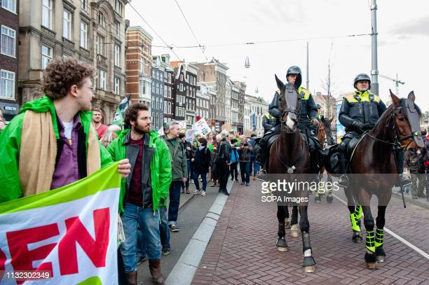 Mounted Dutch police are seen during the demonstration Thousands of people gathered at the Dam square in the center of Amsterdam to demonstrate...