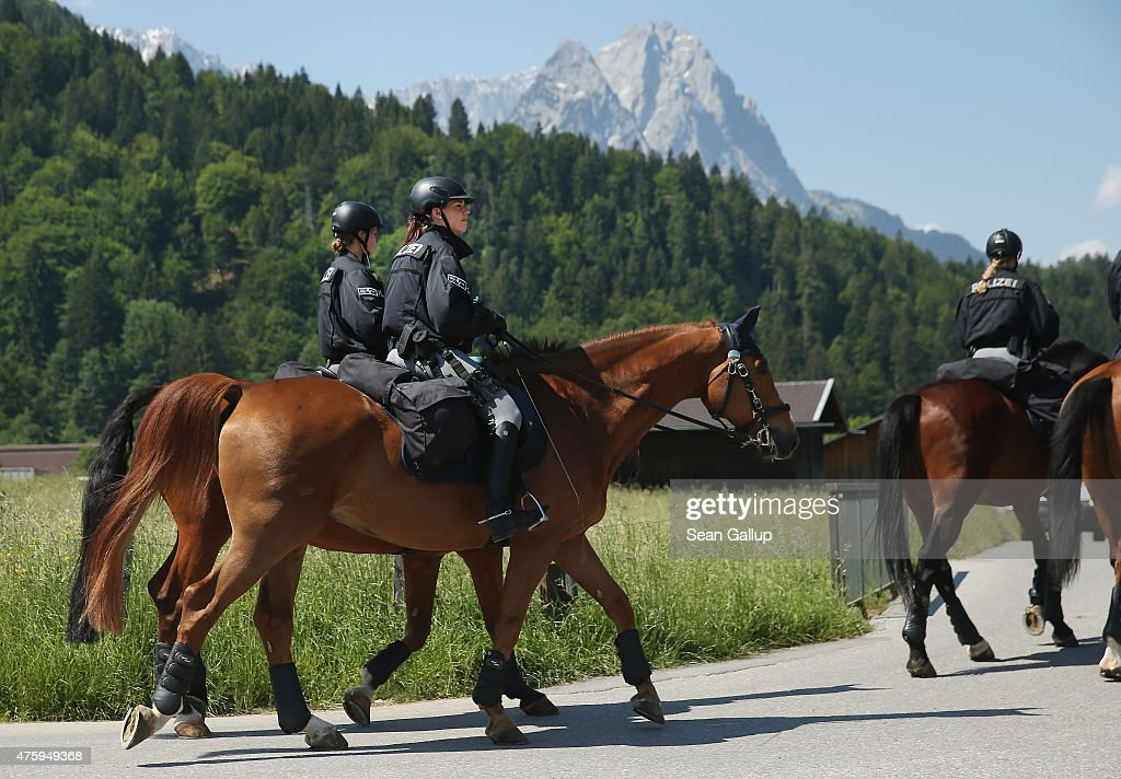 Mounted German police patrol on horses as the Bavarian Alps stand behind two days before the summit of G7 leaders on June 5, 2015 in Garmisch-Partenkirchen, Germany. G7 leaders will meet at nearby Schloss Elmau on June 7-8 and at least 17,000 police members are on hand to safeguard security at the summit.