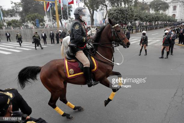 Mounted guard rides controls his horse during the presidential inauguration on July 28, 2021 in Lima, Peru. Castillo of Peru Libre defeated Keiko...