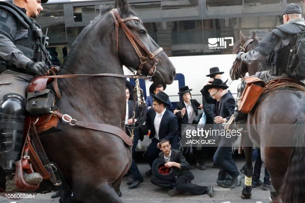 TOPSHOT Mounted Israeli police disperse a group of UltraOrthodox Jews during a demonstration against Israeli army conscription in the Israeli city of...
