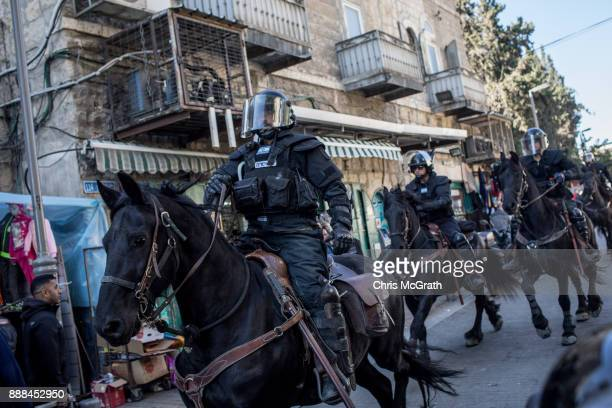 Mounted Israeli police officers clear a street of protesters outside the Damascus Gate of the Old City after Friday prayer on December 8 2017 in...