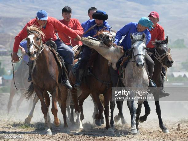 Mounted Kyrgyz riders play the traditional central Asian sport Kokboru know also as Buzkashi or Ulak Tartis during the 'Ethno Fest' festival in the...