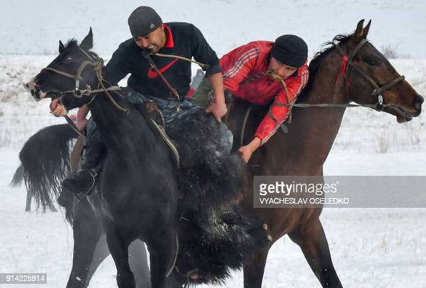 Mounted Kyrgyz riders play the traditional central Asian sport Kokboru know also as Buzkashi or Ulak Tartis near the village of BeshKungey some 20km...