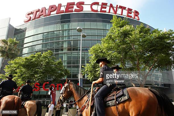 Mounted Los Angeles police officers ride outside at the Michael Jackson public memorial service held at Staples Center on July 7 2009 in Los Angeles...