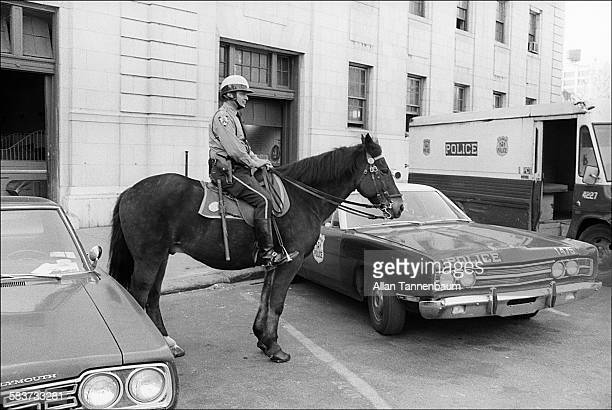 Mounted NYPD officer outside the stable at 1st Precinct New York New York May 15 1974