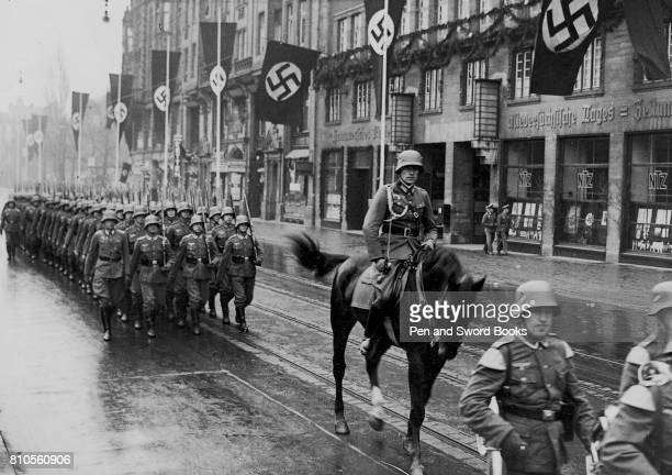 A Mounted Officer Leading a Column of Soldiers Through the Streets