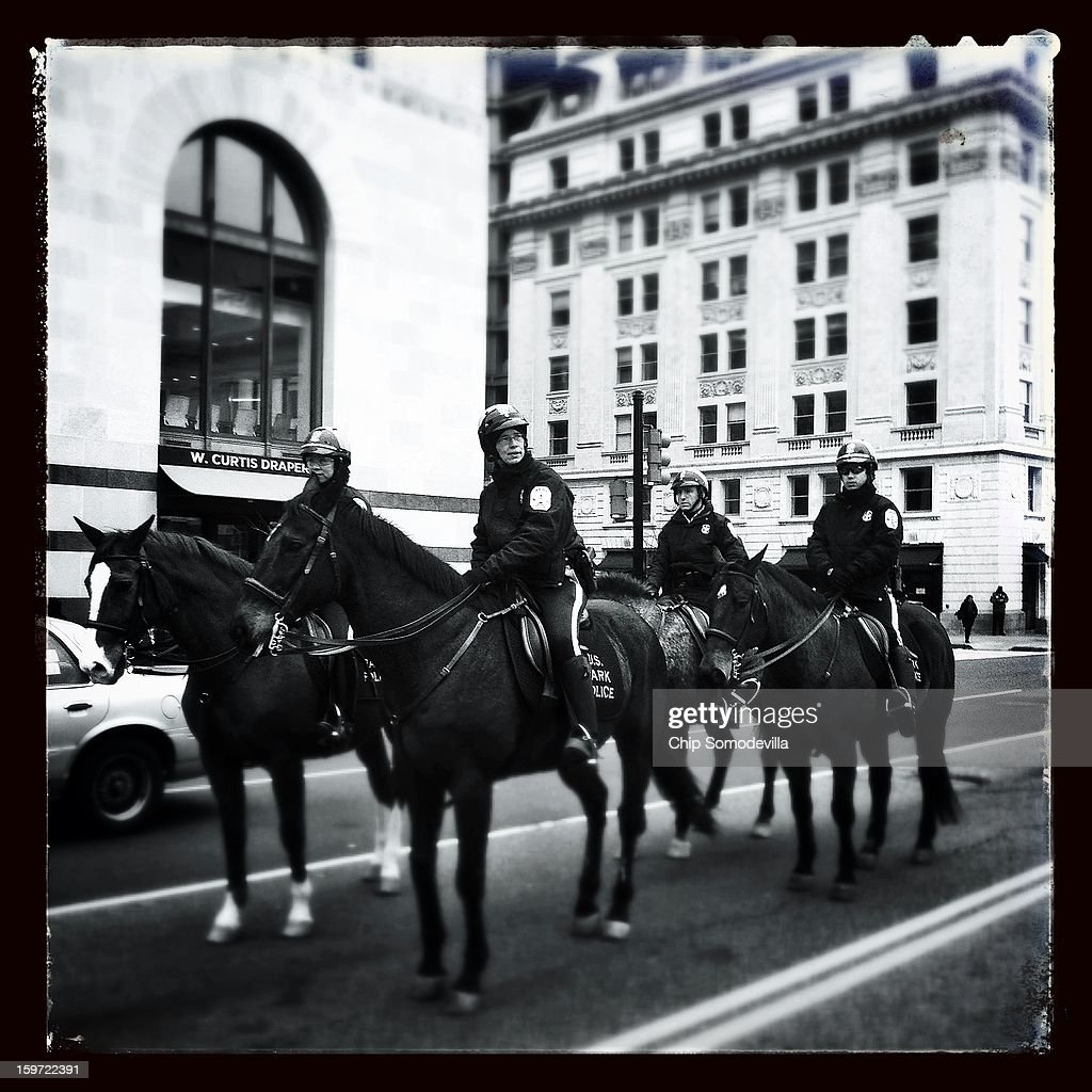 Mounted police and their horses stand in a street January 17, 2012 in Washington, DC. The U.S. capital is preparing for the second inauguration of U.S. President Barack Obama, which will take place on January 21.