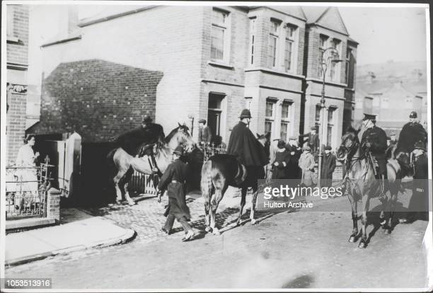 Mounted police clearing off strikers from the works during a strike by chair makers in High Wycombe, England.