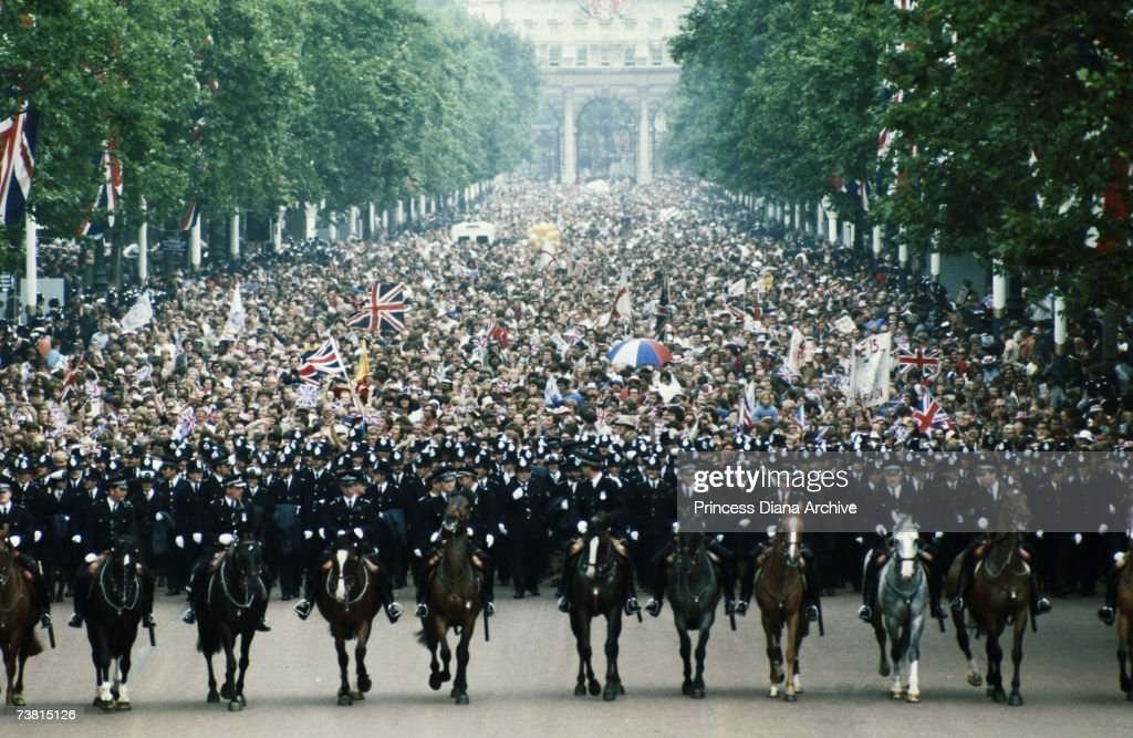 Mounted police contain the huge crowd gathered in The Mall on the day of Prince Charles and Princess Diana's wedding, 29th July 1981.