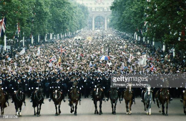 Mounted police contain the huge crowd gathered in The Mall on the day of Prince Charles and Princess Diana's wedding 29th July 1981