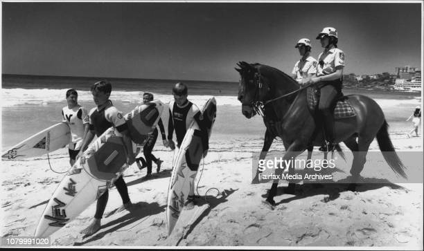 Mounted Police Craig Carter riding Parade and Karen Boggs 27 riding CanobiSurfers L t R Christian Targett Billy McLaughlin Aaron Spicer 14 and Mark...