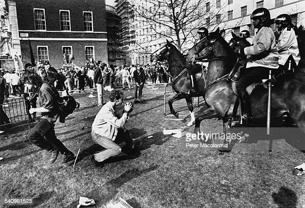 Mounted police during the Poll Tax Riots in London 31st March 1990