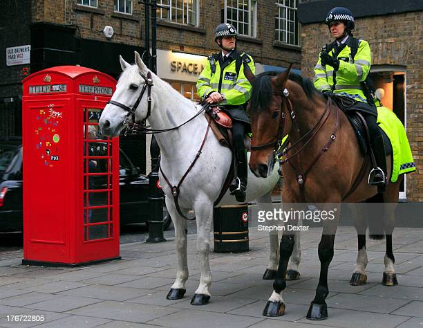 CONTENT] Mounted Police in Covent Garden area of London with red telephone box
