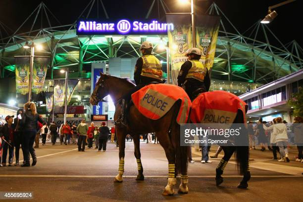 Mounted Police monitor spectators arriving at the 1st NRL Semi Final match between the Sydney Roosters and the North Queensland Cowboys at Allianz...