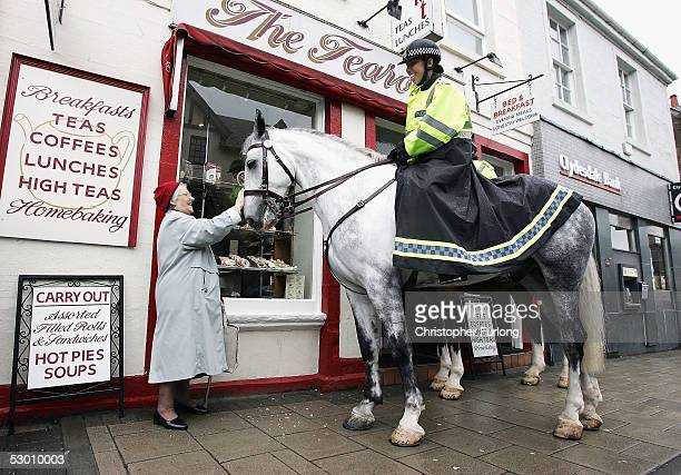 Mounted police officers from Strathclyde Police Force meet locals and show their presence in the Perthshire village of Auchterarder on 2 June 2005...