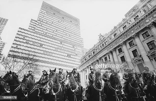 Mounted police officers line the route of a street demonstration in New York City 1981