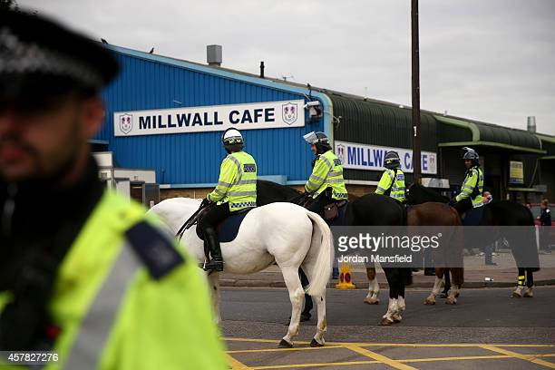 Mounted police officers stand guard outside the ground ahead of the Sky Bet Championship match between Millwall and Cardiff City at The Den on...
