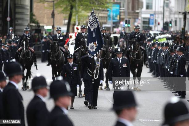 Mounted police officers walk ahead of the hearse carrying the coffin of PC Keith Palmer the officer killed in the March 22 Westminster terror attack...