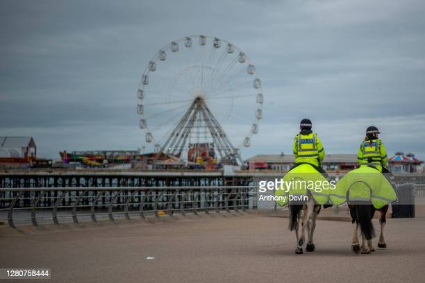 Mounted Police offiers patrol the Promenade on October 17, 2020 in Blackpool, England. Lancashire has entered tier 3 of the government's coronavirus...