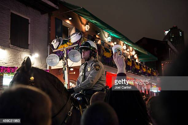 mounted police on bourbon street at mardi gras - equestrian helmet stock pictures, royalty-free photos & images